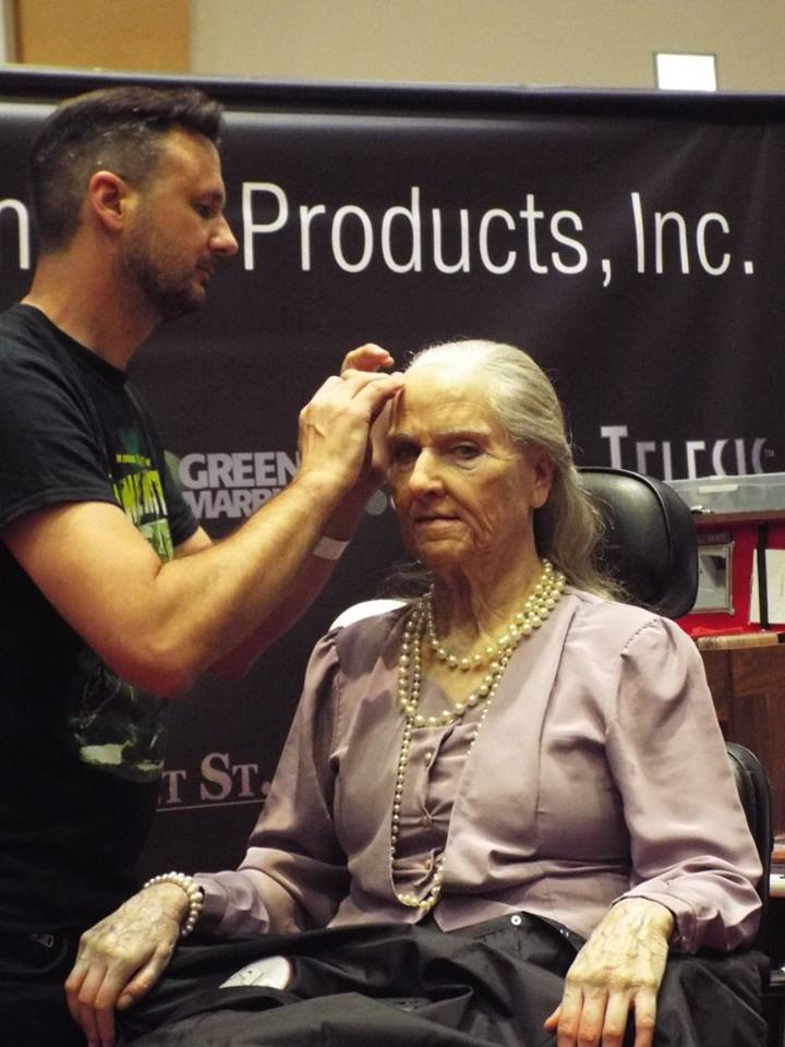 SFX rising star Adrian Rigby creating an 'old age' makeup at the PPI Stand at the UMA Expo in London